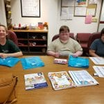 IVI clients sorting and stuffing bags