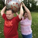 IVI client playing with a large ball outside