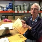 Male IVI client sorting paperwork
